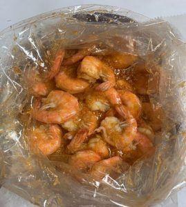 Deveined Shrimp Boil Bag in sauce.