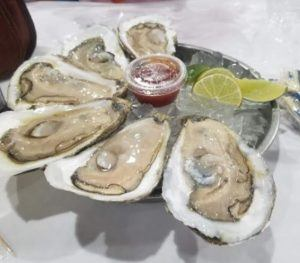 Oysters on the Half Shell with Dipping Sauce and Limes.