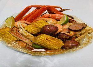 Seafood Boil Bag. Crawfish, Crab Legs, Corn, Sausage, Shrimp Potato, and Lime.