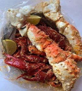 Seafood Boil Bag with Jumbo King Crab Legs, Crawfish and Lime in sauce.