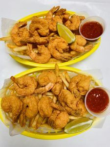 Two Fried Shrimp Baskets with Lime, Dipping Sauce and a side of Fries,